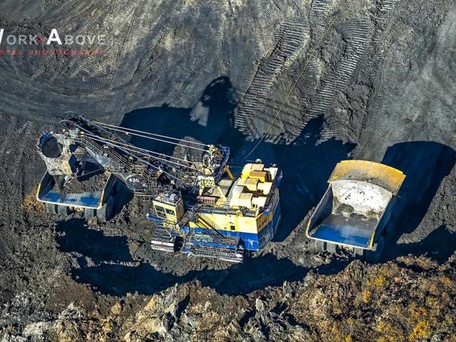 Aerial photo of shovel loading bitumen on giant truck in oilsands