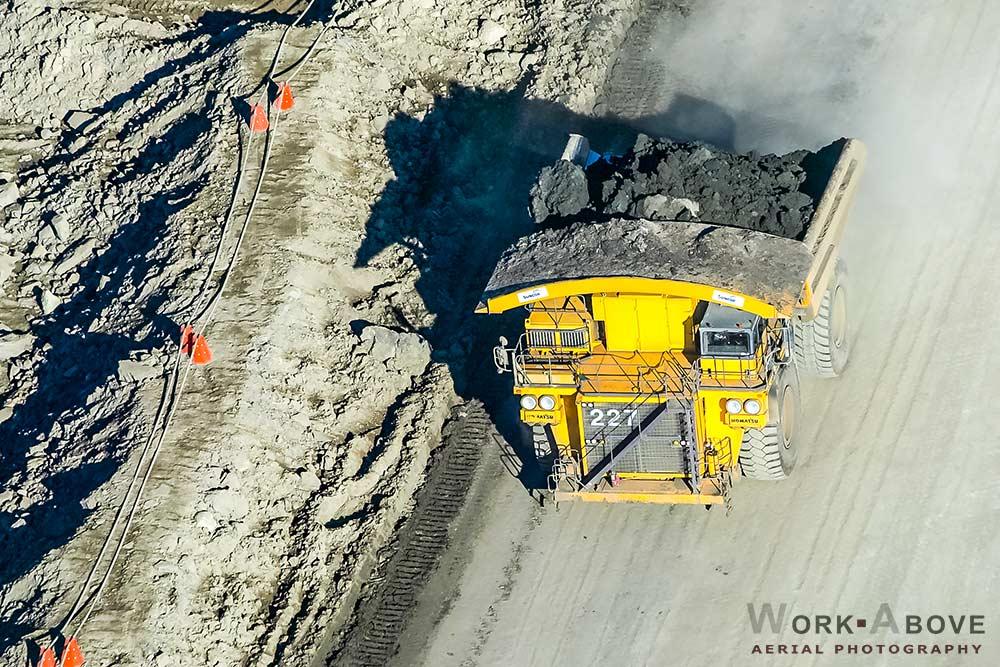 Aerial photo of oil sands truck hauling bitumen